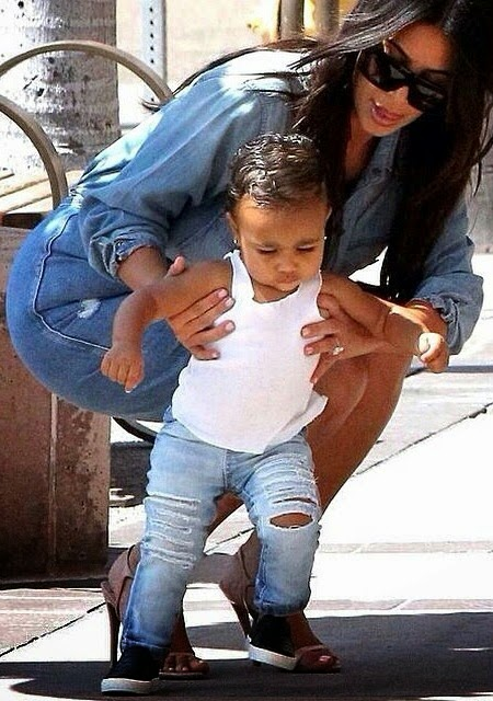 Kim Kardashian seen with daughter North West taking her first stroll in La Jolla, San Diego, California on Wednesday, August 20, 2014 (Photo Credit: Mail Online)