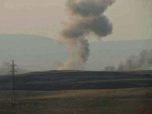 PHOTO: This image made from AP video shows smoke rising from airstrikes targeting Islamic State militants near the Khazer checkpoint outside of the city of Erbil in northern Iraq, Aug. 8, 2014. (Photo Credits: ABC News)