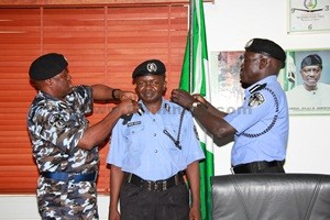CP Aminchi Samaila Baraya being decorated with his new rank by the IGP [Photo Credit: frankmba.com]