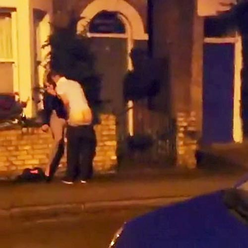 PAY-A-couple-copulating-outside-housing-on-a-well-lit-pavement
