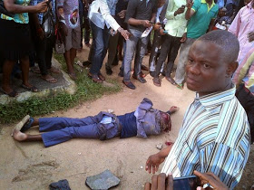 One Of The Kidnappers Lying Helplessly