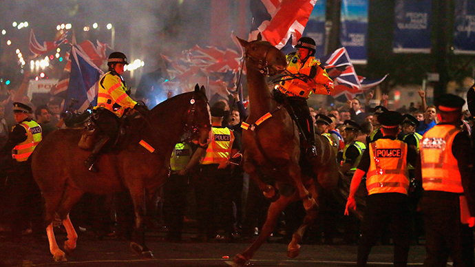 A police horse rears up as pro-union protestors clash with pro-independence protestors during a demonstration at George Square in Glasgow, Scotland September 19, 2014 (Reuters / Cathal McNaughton )