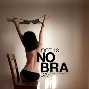"Women Go Topless To Mark The Annual ""No Bra Day"" on Monday, October 13, 2014(Photo Credit:Pulse.ng)"