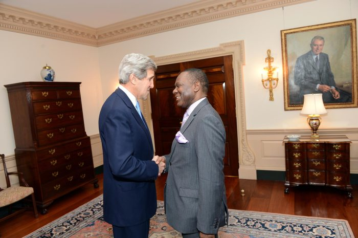 Olugbenga Ashiru, Nigeria's Foreign Affairs Mininister shakes hands with Us Secretary of State John Kerry at a bilateral meeting at the US Department of State in Washington DC on April 25, 2013 (US Government Photo)