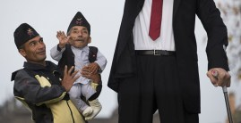 Chandra Bahadur Dangi, from Nepal, (2nd L) the shortest adult to have ever been verified by Guinness World Records, poses for pictures with the world's tallest man Sultan Kosen from Turkey, (R) during a photocall in London on November 13, 2014, to mark Guinness World Records Day. Chandra Dangi, measures a tiny 21.5in (0.54m) the same height as six stacked cans of beans. Sultan Kosen measures 8 ft 3in (2.51m). (Photo Credit: Andrew Cowie/AFP/Getty Images)