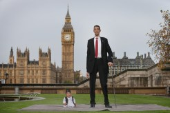 The shortest man ever, Chandra Bahadur Dangi meets the worlds tallest man, Sultan Kosen for the very first time on November 13, 2014 in London, England. Chandra from Nepal measuring 54.6 cm (21.5 inches) posed for photographers with Sultan from Turkey who is 251 cm (8 ft 3 inches). Today is the 10th annual Guinness World Records Day during which thousands of people are expected to come together to celebrate the international day of record-breaking! (Photo Credit: Peter Macdiarmid/Getty Images)