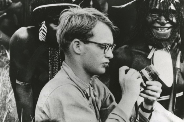Michael C. Rockefeller, son of Nelson Rockefeller is shown as he adjusted his camera before taking pictures of Papuan men in New Guinea (Photo Credit: AP/Rick Homan)