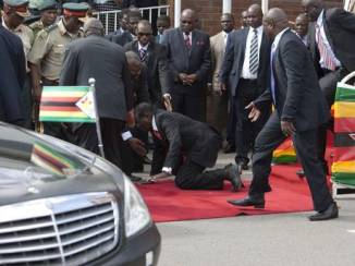 President Robert Mugabe went on all fours on Thursday, February 6, 2015 at Harare International Airport after addressing a crowd on his return from an Africa Union summit in Ethiopia. (Independent UK)