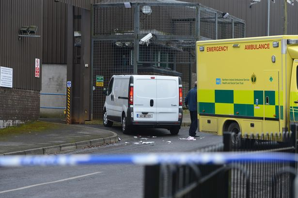 An ambulance at the scene outside St Mary's Church in Newtownbutler, Co Fermanagh after a gunman opened fire on wedding guests on Wednesday, February 11, 2015 killing one man and injuring two others. (Photo Credit: Ronan McGrade/ Fermanagh Herald)