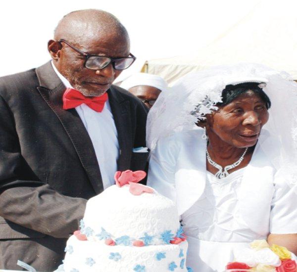 Elder Dikam Garba Dabo'ok and wife,  MrsKa'a Nafung on their wedding day (Photo Credit: The Scoop News)