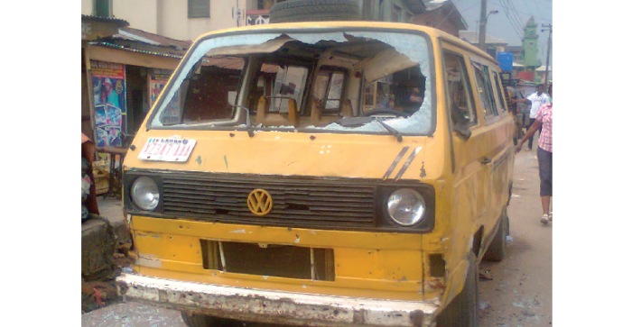 One of the vehicles vandalized during a rival clash in the Mushin area of Lagos state on Monday, March 9, 2015. (Photo Credit: New Telegraph)