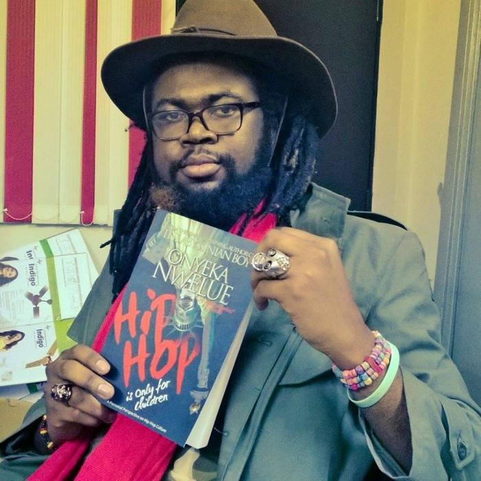 The author, Onyeka Nwelue poses with the book, Hip Hop is Only for Children