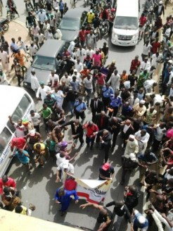 """""""The Traveller surrounded by Buhari supporters"""" Photo Credit: Daily Post"""