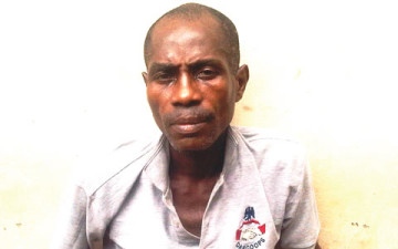 Tokunbo Ojo was on Tuesday, April 14, 2015 apprehended in Lagos State after he used his master key to gain access into a parked car and made away with N3.2 Million during a PDP rally at Ogun State recently. (Photo Credit: Punch)