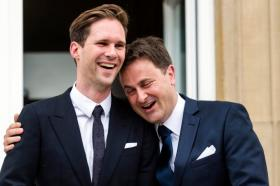 Luxembourg's Prime Minister Xavier Bettel, right, puts his hand around the shoulder of his partner Gauthier Destenay after their marriage at the town hall in Luxembourg, on Friday, May 15, 2015. The marriage comes one year after the parliament approved legislation to turn Luxembourg into an increasing number of countries allowing for same-sex marriages. Bettel and Destenay have been civil partners since 2010. (AP Photo/Geert Vanden Wijngaert)