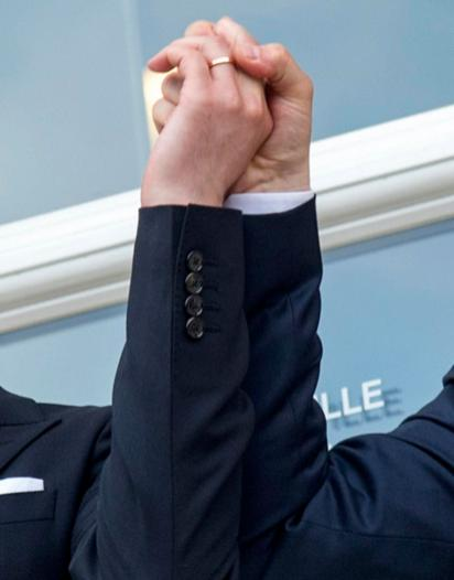 Luxembourg's Prime Minister Xavier Bettel, right, holds up the hand of his partner Gauthier Destenay with a wedding band on his finger, as they leave the town hall after their marriage in Luxembourg, on Friday, May 15, 2015. The marriage comes one year after the parliament approved legislation to turn Luxembourg into an increasing number of countries allowing same-sex marriages. Bettel and Destenay have been civil partners since 2010. (AP Photo/Charles Caratini)