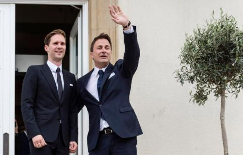Luxembourg's Prime Minister Xavier Bettel, right, waves as he walks out of the town hall with his partner Gauthier Destenay after their marriage in Luxembourg, on Friday, May 15, 2015. The marriage comes one year after the parliament approved legislation to turn Luxembourg into an increasing number of countries allowing for same-sex marriages. Bettel and Destenay have been civil partners since 2010. (AP Photo/Geert Vanden Wijngaert)