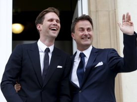 Luxembourg's Prime Minister Xavier Bettel, right, puts his arm around his partner Gauthier Destenay as they leave the town hall after their marriage in Luxembourg on Friday. (Photo Credit: Luxembourg Wort)