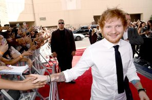 LAS VEGAS, NV - MAY 17: Singer Ed Sheeran shakes hands with fans during the 2015 Billboard Music Awards at MGM Grand Garden Arena on May 17, 2015 in Las Vegas, Nevada. (Photo by Jeff Kravitz/BMA2015/FilmMagic)