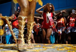 Dancers perform in a street party promoting black pride and encouraging Afro-Brazilian women to flaunt their curls in Rio de Janeiro, Brazil, Sunday, Feb. 8, 2015. Sunday's curl-power celebration in Rio de Janeiro is one of hundreds of street parties that are kicking off in the run-up to Carnival, which starts on Friday. (AP Photo/Silvia Izquierdo)