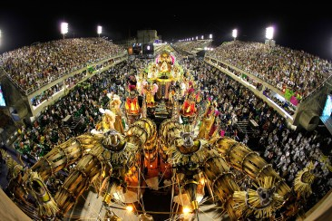 Revellers attend to XXXXXXXX Samba School parade during Rio de Janeiro's carnival on Marques de Sapucai Sambodromo.