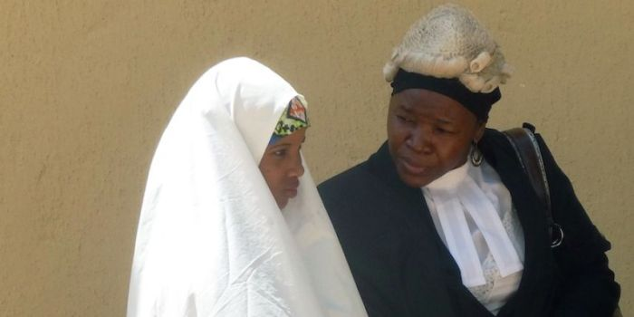 Wasila Tasi'u accompanied by a person responsible for his defense in October, 2014. (Photo Credit: Aminu Abubakar/AFP)