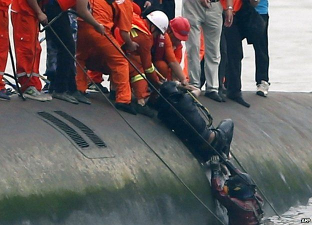 on of the rescued 15 survivors being pulled out by rescuers (Credit: BBC/AFP)