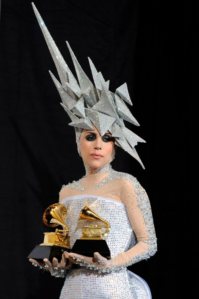 epa02399284 YEARENDER 2010 JANUARY Singer Lady Gaga of the US, holds up her awards for Best Dance Recording and Best Electronic/Dance Album at the 52nd Annual Grammy Awards at the Staples Center in Los Angeles, California, USA, 31 January 2010. The Grammys are presented annually by the National Academy of Recording Arts and Sciences of the United States for outstanding achievements in the music industry.  EPA/ANDREW GOMBERT