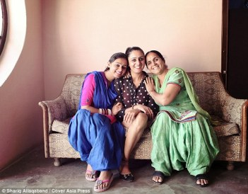 Subhreet's mother (right) Charanjeet Kaur Ghuman, 56, and her younger sister (left) Surmeet Kaur Ghuman, 25, supported her throughout her ordeal, which saw her undergo seven operations (Credit: Cover Asia Press)