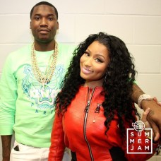 Meek Mill and Nicki Minaj pose for a shot (Credit: Hot 97)