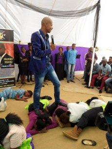 Prophet Penuel stomping on his 'sleeping members' (Photo Credit: Facebook)