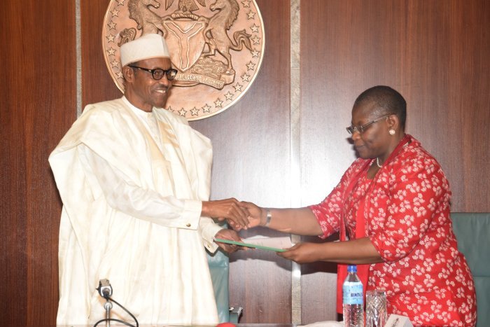 President Buhari receiving 'demands'from the leader of the Bring Back Our Girls Campaigner, Oby Ezekwesili at Aso Rock (State House Photo)