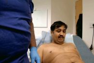 Mohammed Abad who lost his original manhood to an accident at a tender age, stares at his newly fitted penis moments after the surgery. (Photo Credit: The Sun)