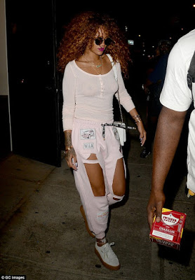 27-year-old Rihanna bared her nipples again in transparent top and cut-out sweatpants as she went to a tattoo parlor in her New York neighborhood on Wednesday, August 12, 2015. (Photo Credit: GC Media)