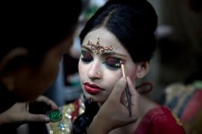 15 year old Nasoin Akhter has her makeup done at a beauty parlour on the day of her wedding to a 32 year old man, August 20, 2015 in Manikganj, Bangladesh. (Photo Credit: Allison Joyce/Getty Images)