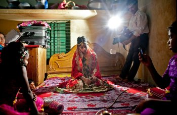 15 year old Nasoin Akhter poses for a video on the day of her wedding to a 32 year old man, August 20, 2015 in Manikganj, Bangladesh. (Photo Credit: Allison Joyce/Getty Images)