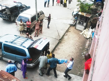 The corpse of 23-year-old albino, Ugochukwu Ekwe, being evacuated by the police from their apartment in Festac town where he committed suicide on Sunday, August 16, 2015 over his skin condition. (Photo Credit: Punch)