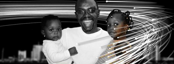 Loving Father: Emeka Jeffrey Onuoha with his 2 daughters | Facebook
