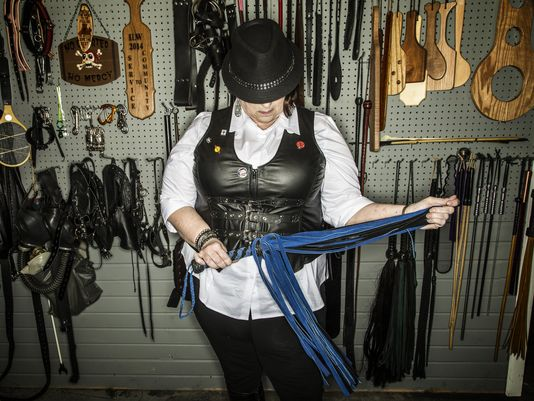 Dominatrix Ms. Robin stands in the basement dungeon of her West Des Moines home Feb. 10, 2015. | Zach Boyden-Holmes/The Des Moines Register)