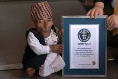 Chandra Bahadur Dangi, 72, poses for a picture with his certificate after being announced as the world's shortest man living, as well as shortest person ever measured by the Guinness World Records, in Kathmandu February 26, 2012. (Photo Credit: REUTERS/Navesh Chitrakar)
