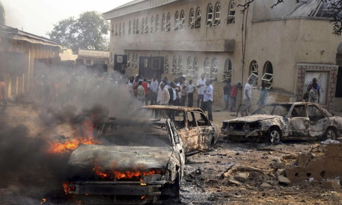 Islamizing Nigeria Through Terrorism: A car burns at the scene of a Christmas Day bomb explosion that the Islamist militant group Boko Haram claimed responsibility for at St. Theresa Catholic Church at Madalla, Suleja, just outside Nigeria's capital Abuja on December 25, 2011. | Reuters/Afolabi Sotunde