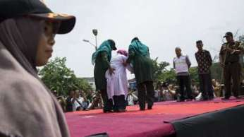Three women as well as 14 men were flogged in Indonesia for pre-marital sex.