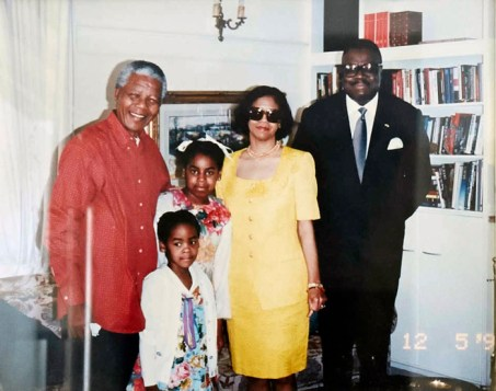 Bim (front), her sister and parents pose with family friend Nelson Mandela.