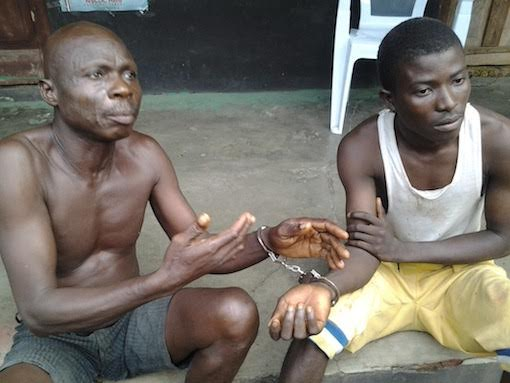 Two suspects identified as Oke Akindele, a herbalist from Igangan, Benin Republic, and 19-year-old Timothy Oniyide, a welder who were arrested for exhuming corpse in Ogun State. (Photo Credit: PM News)