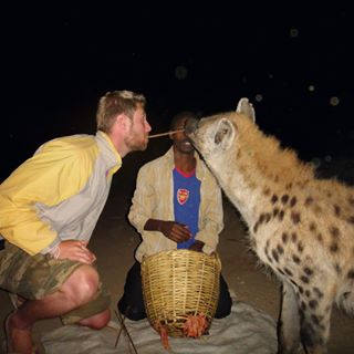 Johnny Ward meets a wild cat in Ethopia