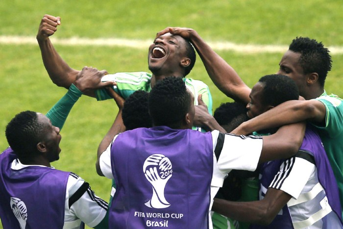 Nigeria's forward Ahmed Musa (C) celebrates scoring his second goal with teammates during the Group F football match between Nigeria and Argentina at the Beira-Rio Stadium in Porto Alegre on June 25, 2014,during the 2014 FIFA World Cup. | Adrian Dennis/AFP/Getty Images