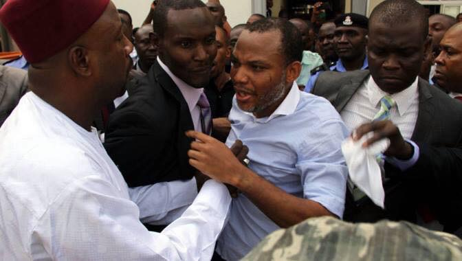 Radio Biafra Director, Nnamdi Kanu being pushed and shoved by DSS officials at the court house, Monday, November 23, 2015 | Facebook