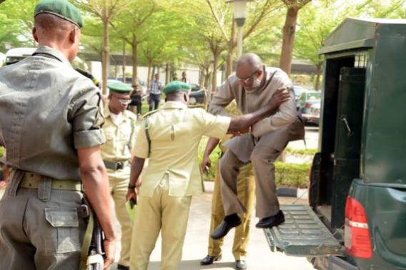 Chief Olisah Metuh, National Publicity Secretary of the PDP arrives the courts Tuesday, Jan 19, 2015 in handcuffs | NAN