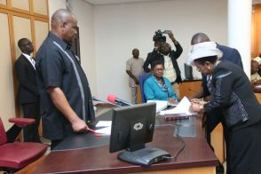 Justice Daisy Okocha signing her sworn oath of office. | Facebook