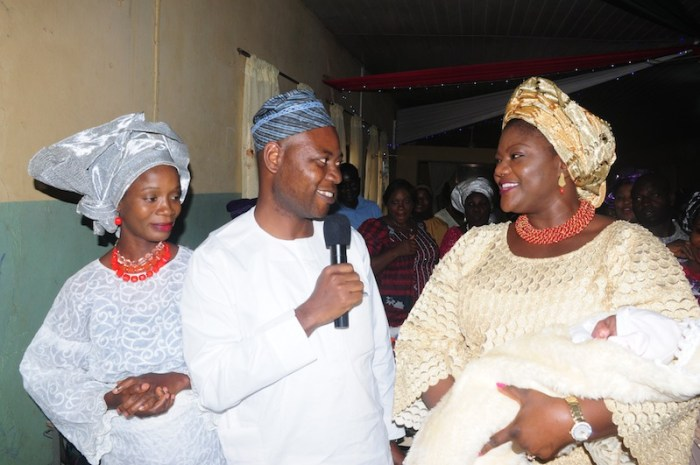 Ondo First Lady, Mrs Olukemi Mimiko, wrapping First Baby of the Year, Baby Adewon, around her arms, State Commissioner for Health, Dr Dayo Adeyanju and Mother of the First Baby, Mrs Adewon at the Post-Natal ward of the State Specialist Hospital Akure on Friday | Ondo TV